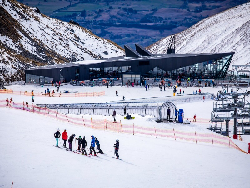 Packed mountain full of skiiers and snowboarders at The Remarkables