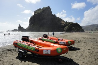 Piha Surf Life Saving Club IRBs with Lion Rock