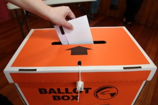 vote in ballot box